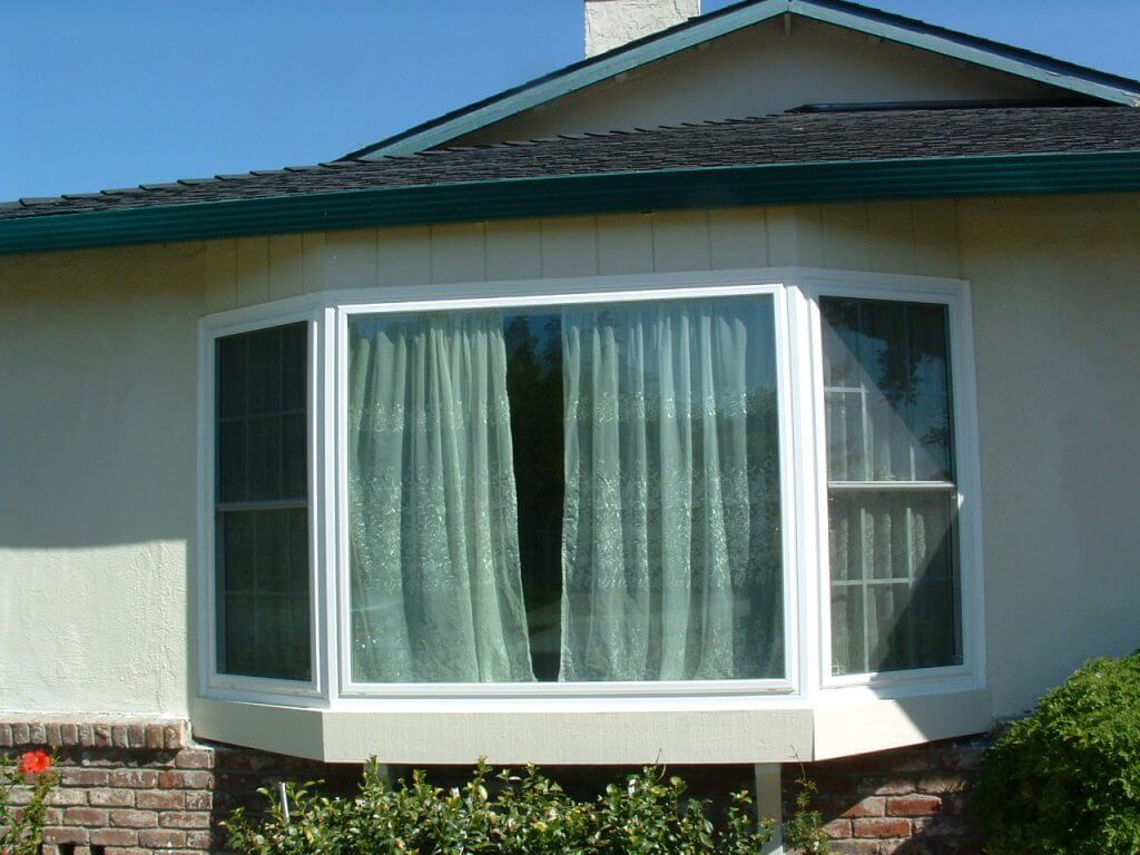 New construction bow window with vent grids r m quality for Quality windows